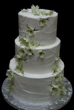 This blue a few light blue flowers and the little green wedding penguins on top is absolutely perfect :)