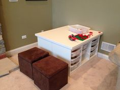 2 Ikea Trofast units back to back with an MDF table top. Great for containing all the Legos!