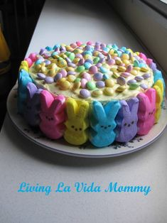 Easter Cake  1 box lemon cake mix  1 can(s) lemon frosting  2 bag(s) off diffrent easter candies.....Peep Cake 2