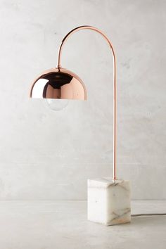 This sleek marble stone lamp with copper accents is a statement piece for any stone lover's home.