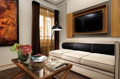 Babuino 181 in Rome, Italy - Classic Suite: Oversized chair and plush sofa in the sitting area.