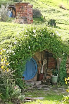 Hobbit house - with an enchanting entryway surrounded by an Arch of Greenery