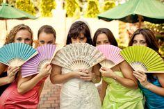 Bride and bridesmaids with hand fans. Photo by Casey Fatchett - www.fatchett.com