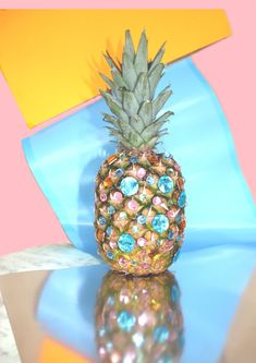 why is this pineapple bedazzled? i don't know. but this photo is really fun.