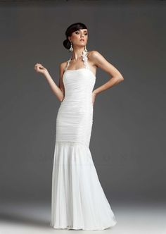 You Will Be The Center Of Attention With White Collection By Mignon This Fit And Flare Gown Features A Ruched Bodice An Open Back