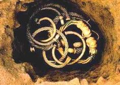 Snettisham Treasure. Iron Age. 100BC twelve torcs, gleaming with gold and silver as they were found in a pit in the ground.