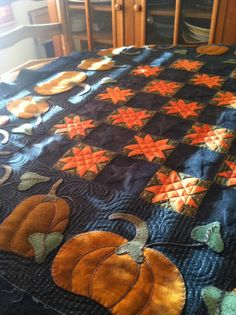 Midnight Harvest, by Lisa Bongean. This wool quilt has some nice quilting.