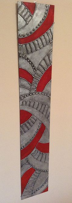 Hot Glue Gun Art - Spray painted with Metallic Silver, distressed with black paint and highlighted with a Red Glaze.