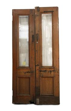 Victorian brownstone antique entry doors with a single pane of glass at the top of each door and a single recessed panel at […]