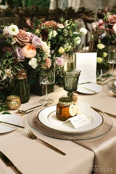 We love centrepieces that are full of greenery. | Photography: Micheal Beaulieu Photography | WedLuxe Magazine #luxury #wedding #luxuryweddings #torontowedding #centrepieces #flatware #tableware #favors #floral #receptiondecor #weddingdecor