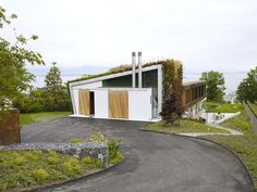 design paradigms jewel box villa switzerland.  Nice living area integrated to pool and driveway approach to house.