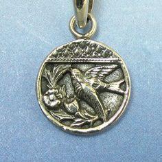 Silver Bird Pendant Antique Victorian Button Sterling Silver Pendant Sparrow in Flight. $26.00, via Etsy.