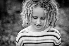 little girl with dreadlocks and striped shirt