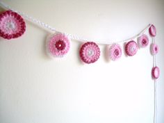 Hey, I found this really awesome Etsy listing at http://www.etsy.com/listing/104046124/crochet-garland-pink-nursery-wall