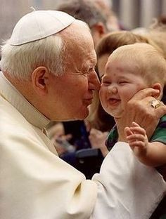 This is the happiest picture I've ever seen. Pope Saint John Paul II with a baby