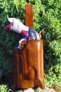This Holster is specifically molded to the Nerf Zombie Hammershot Gun. Its designed with a subtle western motif, and hangs low on your belt for