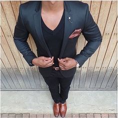 Choose a black blazer and black chinos to look classy but not particularly formal. Tap into some David Gandy dapperness and complete your look with tobacco leather loafers. Shop this look on Lookastic: https://lookastic.com/men/looks/blazer-v-neck-t-shirt-chinos/24017 — Black Blazer — Black V-neck T-shirt — Dark Brown Silk Pocket Square — Dark Brown Leather Watch — Brown Leather Watch — Black Chinos — Tobacco Leather Loafers