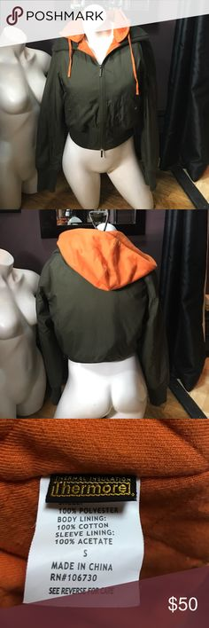 Vince. Hoodie bomber jacket. Army green & orange Vince. Hoodie bomber jacket. Army green & orange. Removable hood with two zip side pockets and a little arm zip pocket on left shoulder. In excellent condition except a few small snap holes on collar. Not really noticeable and totally fixable. Kind of just looks like a distressed look. Otherwise no flaws. Vince Jackets & Coats