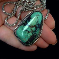 A Magnificent Large Chunky Vintage #NativeAmerican #TurquoiseNecklace Pendant, Navajo Handcrafted in Solid Sterling Silver with Vintage 24 Sterling Silver Hallmarked Rope Chain featuring a Bezel-set Exquisite Rich Natural Nevada Green Turquoise Gemstone with Black Spiderweb Matrix and Twisted Rope Border, Hidden Bail, from the Southwest Native American Indian Navajo Tribe, Weighty 36.2 Grams circa 1980s! Measurements for the Pendant are over 1-3/4 in length by 1-1/4