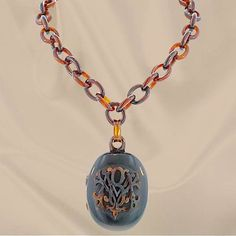 Victorian Tortoise Shell Locket and Chain. Victorian tortoise shell chain link necklace with a drop tortoise shell locket featuring entwined initials.