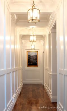 WAINSCOTING - A LOOKBOOK What a gorgeous hallway; love the lights, the wainscoting, the colors. Very sharp