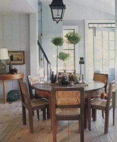 love the round dinning room table.   Steven Gambrel - The World of Interiors