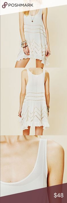 Voile and Lace Trapeze Slip Sheer dotted slip dress with lace inset throughout. Ruffled hem.  Perfect condition no stains or defects. Free People Dresses Mini