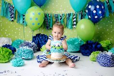 Idaho Falls, ID baby and child birthday photographer. Caralee Case Photography. cake smash green and blue girl balloons #cakesmash #firstbirthday #pictures #oneyear