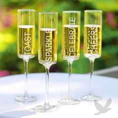 Celebrate! Contemporary Champagne Flutes - Cute! Could DIY with glass stenciling kits.