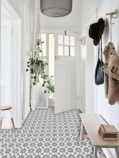 The beautiful hallway and front door of Lynda's third floor apartment. 'The wonderful thing about old apartments,' tells Lynda, 'is the high ceilings and spacious rooms – even the hallway is roomy!' Photo – Eve Wilson for The Design Files. Home Interior, Interior And Exterior, Interior Design, Interior Doors, Interior Architecture, Hallway Decorating, Entryway Decor, Entryway Ideas, Hallway Ideas