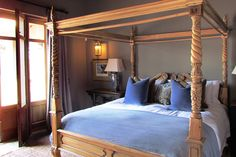 Bedroom 3 - carved four poster with french velvet scatters