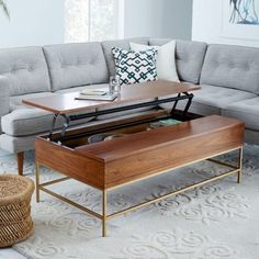 Save precious space with this sleek wooden coffee table that double as storage!