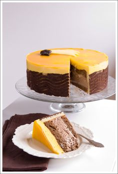 A delicious almond chocolate cake, chocolate mousse, mango mousse topped with a mirror glaze of mango. Beautiful luxury dessert for that very special occasion. Mango Chocolate, Chocolate Mousse Cake, Almond Chocolate, Chocolate Mouse, Sweet Recipes, Cake Recipes, Dessert Recipes, Cupcakes, Cupcake Cakes