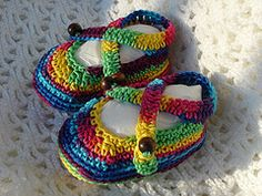 Baby rainbow sandals pattern from itsatoy blogspot.  Free pattern listed on ravelry, but this pin is connected directly to the blog and pattern.  Three cheers too, because I could never get it to open from ravelry before! Thank you for getting this page to open and getting a pin stuck on it!!