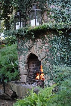 outside stone fireplace with lanterns.  Could be used as a bbq pit or just place to warm up for outside entertaining.