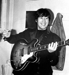 """John 1966 playing his Casio Epiphone 6 string hollow body guitar. Both Lennon and Harrison were hooked on the Casino after getting an earful of the crisp tones and bristling sustain produced by McCartney's Bigsby adorned instrument, which he played on """"Drive My Car"""" and """"Taxman.""""  When the Revolver sessions began a year later, Lennon and Harrison purchased new 1965 models of their own, making the Beatles (at that time) an all-Casino band. Harrison's guitar sported a Bigsby unit."""