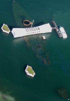 I would love to visit this memorial one day, why not do it with Carnival Cruise Lines?! An aerial view of the USS Arizona Memorial/Pearl Harbor. #Hawaii (photo by Shawn Buresh)