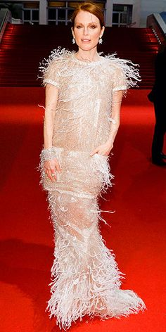 On the Red Carpet at Cannes | JULIANNE MOORE | If the actress's gown looks vaguely familiar, that's probably because it reminds you of what Blake Lively recently wore at Cannes. At the Map to the Stars premiere, Julianne sports a more covered-up style, a short-sleeve number covered in feathers, pearls and paillettes from the same Chanel Couture Spring 2014 collection.