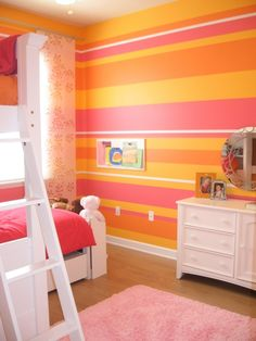 Striped bedroom for 2, This is the bedroom that my 3 & 5 year old girls share.  One likes pink, the other yellow, so we added some orange and went with it.  It is bright and cheerful which fits them well., We did two of the wall striped.  The rest are in the yellow color.  The white bands are actually wood moulding strips to add a bit more interest and dimension to the walls. , Girls Rooms Design