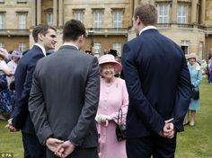Experienced hostess: The Queen was swamped by members of Team GB Olympic Water Polo team