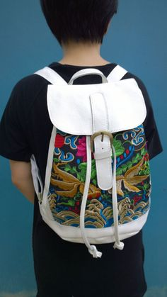 A personal favorite from my Etsy shop https://www.etsy.com/sg-en/listing/254390649/white-hmong-boho-leather-embroidery-bag