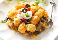 <p>This Tater Taco Casserole is a dish that the whole family will love.</p> <p>Everyone loves tater tots and everyone loves Mexican food so why not combine the two!</p> <p>Start by browning some beef, onion, and garlic. Next, we add a whole bunch of flavor so hold on to your shorts. Add some green chiles, taco seasoning, black beans, corn, and cheese. So easy! Pour this into your prepared baking dish and top with tater tots. Drizzle some enchilada sauce on top to give those tater tots an…