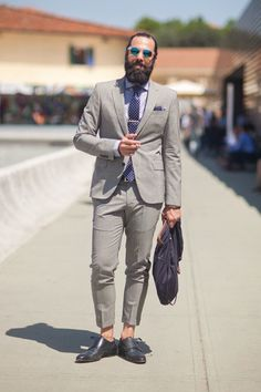 Sunglasses and an ankle - baring suit