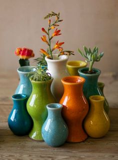 Add a pop of color to your tabletop with this set of 13 Multi-Colored Ceramic Vases.
