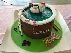 Pool cake with unicorn float ring from The Cake Shack Lane Cove