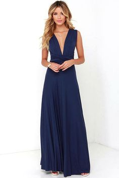 """Versatility at its finest, the Tricks of the Trade Navy Blue Maxi Dress knows a trick or two... or four! Two, 75"""" long lengths of fabric sprout from an elastic waistband and wrap into a multitude of bodice styles including halter, one-shoulder, cross-front, strapless, and more. Stretchy, navy blue jersey knit hugs your curves as you discover new ways to play with this fascinating frock. Full, maxi-length skirt has a raw hemline. Want Styling Tips? <a href='http://bit.ly/HowToWearIt'…"""