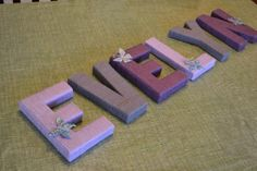 Learn how to make beautiful, yarn-wrapped letters for your nursery or kid's room with this easy, step-by-step tutorial.