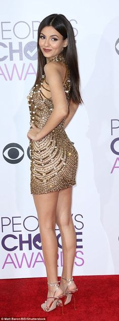 Brunette beauty: Victoria Justice stunned in a beaded mini dress and silver heels...