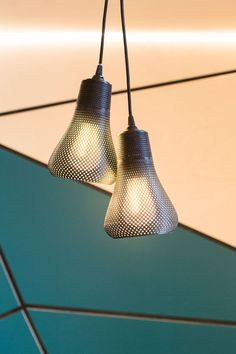 The lights hanging above the tables in this cafe are pairs of Kayan pendants from Plumen.