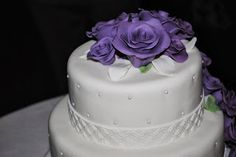 Wedding cake with purple flowers